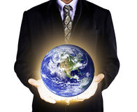 Earth care with helping businessman hands Royalty Free Stock Images