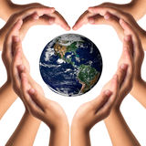 Earth care with helping hands concept royalty free stock photos
