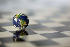 Earth at the chess board. Planet Earth at the chess board Royalty Free Stock Photos