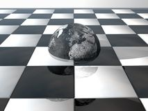 Earth on chess board Royalty Free Stock Images