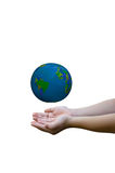 Earth on child hand Stock Images