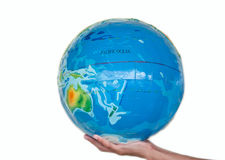 Earth on children hand Royalty Free Stock Images