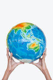 Earth on children hand Royalty Free Stock Photo