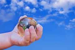 Earth in a children's hand. Stock Image