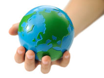 Earth in a children's hand Royalty Free Stock Images