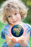 Earth in children`s hands vector illustration