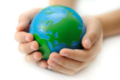 Earth in a children's hands. Isolated on white background Stock Photography