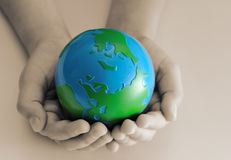 Earth in children's hands. Sepia, close up Royalty Free Stock Photos