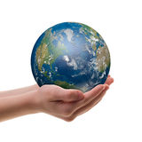 Earth in childs hands stock photos