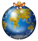 Earth Christmas ball. A Christmas ball decorated with a Europe-Asia-Africa world map Royalty Free Stock Photo