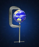 Earth Clamp. A metaphorical photo of a clamp that is squeezing the earth Stock Images