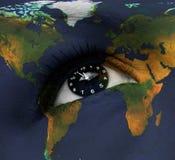 Earth clock in eye Stock Image