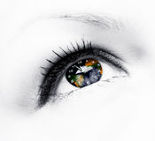 Earth clock in eye Royalty Free Stock Images