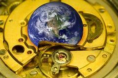 Earth clock mechanism. Stock Image