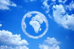Earth Cloud. A cloud the shape of the earth sits in the middle of a blue sky Royalty Free Stock Images