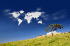 Earth Clouds. Map in sky with field and tree Stock Photos