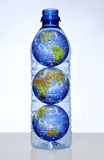 Earth with Continents in Water Bottle. Earth with continents inside empty water bottle stock photos