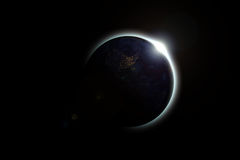 The earth covers the sun in a beautiful solar eclipse. The dark side of planet earth, Elements of this Image Furnished By NASA. Concept science, space Royalty Free Stock Photography