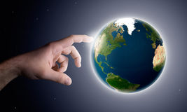 Earth creation. The God hand creates the planet earth Royalty Free Stock Photos