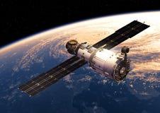 围绕Earth.3D场面旋转的空间站 图库摄影