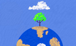 Earth Day. A tree protected by a cloud grows out of the Earth Royalty Free Stock Photography