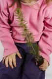 Earth day. A young girl holding a tree seedling Stock Photo
