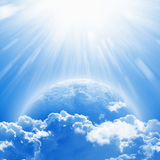 Earth Day. April 22 International Mother Earth Day, blue planet Earth in white clouds, bright sunlight from above. Elements of this image furnished by NASA nasa Royalty Free Stock Photos