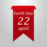 Earth Day April 22. Red ribbon on a gray background Stock Photography