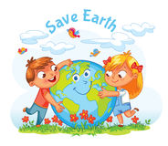Earth Day. Boy and girl hugging the Globe Royalty Free Stock Image