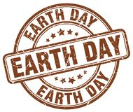 Earth day brown stamp. Earth day brown grunge round stamp isolated on white background royalty free illustration