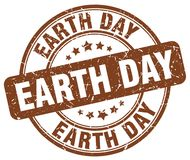 Earth day brown stamp. Earth day brown grunge round stamp isolated on white background vector illustration
