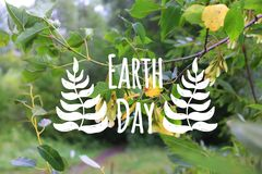 Earth day card decorated hand drawn leave on the green forest background stock photography