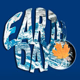 Earth Day concept in blue and orange. Earth Day environmental concept in contrasting colors of blue and orange with leaf and planet. Planet component courtesy of vector illustration