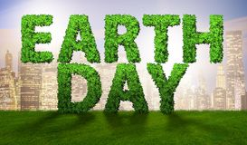 The earth day concept with green letters - 3d rendering stock images