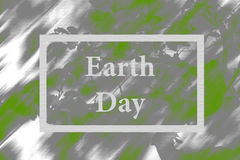 Earth Day. Congratulation on a holiday on a gray green background in a frame Royalty Free Stock Images
