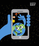 Earth Day. Earth selfie. Planet earth and mobile phone. Planet e Royalty Free Stock Images
