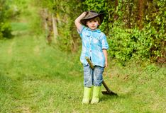 Earth day. Eco life. summer activity. small kid gardener having fun. human and nature. farming and agriculture. Cultivation. happy child farmer play with garden royalty free stock photos
