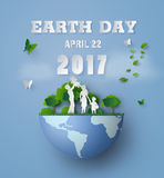 The earth day with family. Concept of eco and earth day with family.paper art and carft style Stock Photography