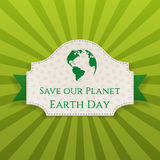 Earth Day greeting Card on green Ribbon Royalty Free Stock Photos