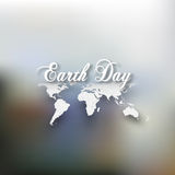 Earth Day. Greeting card with the words, world map on blurrred background. Vector illustration Stock Photography