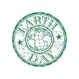 Earth day grunge rubber stamp. Green grunge rubber stamp with the symbol of the earth and the text Earth Day written inside the stamp royalty free illustration