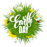 Earth Day Lettering poster with title. Green globe planet with grass and flowers. Vector illustration Royalty Free Stock Photo