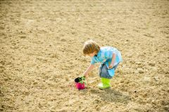 Earth day. new life. summer farm. health and ecology. ecology life. human and nature. happy child gardener. botanic. Worker. Spring season. small kid planting a royalty free stock images