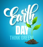 Earth Day poster. Vector illustration with the Earth day lettering, planets and green leaves Stock Photography