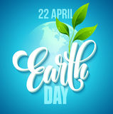 Earth Day poster. Vector illustration with the Earth day lettering, planets and green leaves Royalty Free Stock Images