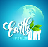 Earth Day poster. Vector illustration with the Earth day lettering, planets and green leaves. EPS10 Royalty Free Stock Photography