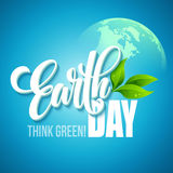 Earth Day poster. Vector illustration with the Earth day lettering, planets and green leaves Stock Image