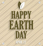 Earth Day poster on wooden background with leafs. Vector illustration Stock Images