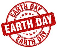 Earth day red stamp. Earth day red grunge round stamp isolated on white background stock illustration