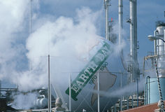 Earth Day sign at oil refinery Royalty Free Stock Images